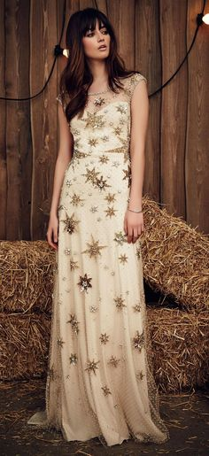 Jenny Packham Spring 2017 Jolene off-white wedding dress with starburst-shaped gold and crystal appliqués and crystal-lined illusion neckline