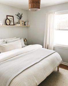 bedroom | grey room | floating shelf | white bedding | rattan pendant | interior design