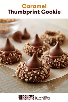 Show off your sweet cookie skills with this Caramel Thumbprint Cookies recipe using HERSHEY'S KISSES Brand Milk Chocolates. Combining pecans, HERSHEY'S Kisses and HERSHEY'S Cocoa, these blossom cookies are the ultimate dessert for the holidays. Make this on your own and wow your holiday guests!