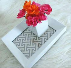 Fabric under a picture frame for a cute tray for a centerpiece