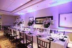 #reception #navywedding #weddingreception #bluelights #weddingdecor #whiteflowers #centerpieces