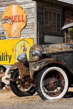 Rusted truck and signs