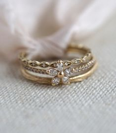 Sweet and delicate details create the Camellia Stack, a blend of sparkling white diamonds and 14K gold. The twig stacking ring (molded from a branch right outside Sofia's home!) plays with the eye-like shape of the Petite Marquise Pave Eternity Band and the center flower shape. This dainty ring stack would be precious in any metal--yellow, white or rose.