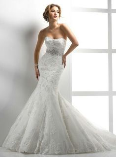 Usually I could never have pictured myself in a lace gown, but if I ever did it would look like this