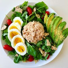 i've been craving tuna lately, so made myself this tuna salad for lunch! deets: sweet pea greens topped with tuna salad (@safecatchfoods tuna mixed with @chosenfoods harissa avocado mayo+pepper+pink salt), hard-boiled pasture-raised egg, avocado, cherry tomatoes & crumbled crackers.
