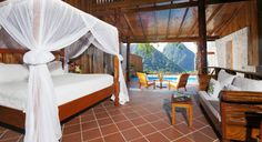 Ladera Resort Soufriere, Caribbean Adult-only Bedroom Honeymoon Luxury Resort Romance floor indoor property room wooden Villa cottage interior design real estate Suite wood furniture Ladera Resort St Lucia, St Lucia Resorts, Caribbean Resort, Caribbean Vacations, Honeymoon Hotels, Unique Hotels, Luxury Accommodation, Saint Lucia, Places
