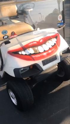@muckrock street art gold tooth red lips smile golf cart