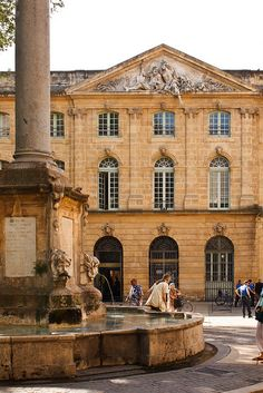 "Aix-en-Provence - La Halle aux Grains by bacasr, via Flickr - In the eighteenth century, Aix honors its main financial resource by building an ""Halle aux Grains"" worthy of an Italian palazzo (architect Georges Vallon).  The building is crowned by an allegorical pediment & adorned with decorative motifs related to the function of the building: fruits, grains, olives. The Hall now houses the offices of the Mayor and post office."