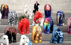 A herd of 'baby elephants' hand-painted by artists and designers including Tommy Hilfiger and Matthew Williamson