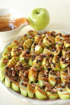 Apple Nachos  Slice green apples. Squeeze lemon juice on them to prevent browning. Drizzle with caramel sauce, mini chocolate chips & crushed walnuts. Enjoy!