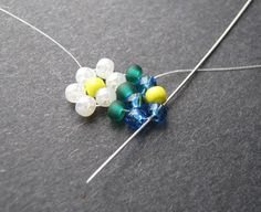 Pick up 2 petal and 1 pollen bead. Stitch up through the top petal bead in the work. Pony Bead Patterns, Beading Patterns Free, Beading Tutorials, Beaded Jewelry Designs, Bead Jewellery, Diy Jewelry, Daisy Bracelet, Daisy Pattern, Bead Loom Bracelets