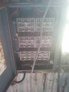 Old fuse board containing asbestos material. Discovered during Pre-demolition asbestos survey Edinburgh.