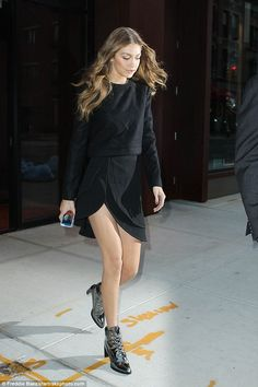Her own best advert: She seemed to be wearing the specchio iron grey edition of the Gigi B...