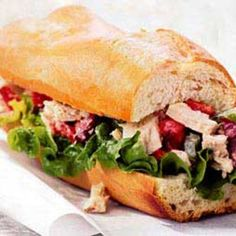 Our tuna salad has a Mediterranean twist: olives and roasted red peppers. Have this sandwich for lunch at home or work or on a picnic, served with a tomato salad.         Active time: 20 min   Start to finish: 20 min