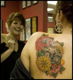 Holy amazing and love reaction .. freshly done apparently #tattoo #flowers #camera