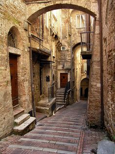 Perugia. Twisty medieval alleys and archways. This aligns with my interests.