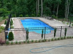 Inground Pool Fence Ideas semi inground pools with green scenery semi inground pools with black metal fence housefashions Fenced In Pool Ideas