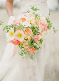 Fresh summer bouquet with soft pink and orange roses ranunculus and peonies - lovely !
