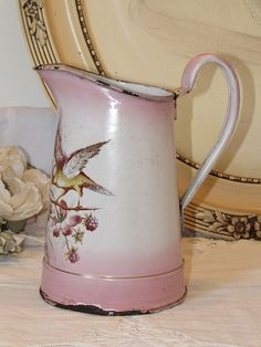 Fabulous French vintage enamel pitcher / jug. Pink with bird and flowers…