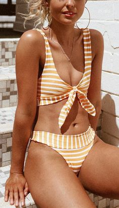 Sweet striped bikini set features a plunge bikini top with front knot closure and scoop back, removable cups, as well as a pair of matching high cut thongs.