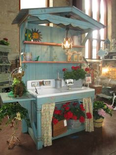 Potting Shed, chandelier, sink..all under a tin roof