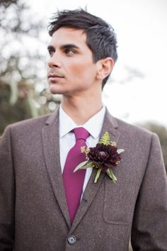 Brown suit, maroon tie, and gorgeous burgundy boutonniere: http://www.stylemepretty.com/california-weddings/ojai/2014/06/24/rustic-elegant-styled-winter-wedding-shoot-at-bodees-rancho-grande/ | Photography: Jessica Lewis - http://jessicalewisphoto.com/