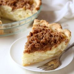 """""""This is not your average apple pie. Nestled amongst chunks of apples is a sweet sour cream filling, baked in a flaky, all-butter crust and topped with a crumbly cinnamon streusel. It's a wonderful pie to welcome fall, but perfect for the tail end of summer, too."""" - Annalise from Completely Delicious"""