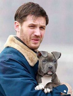 Tom Hardy films on the set of upcoming thriller Animal Rescue with an adorable puppy in New York.