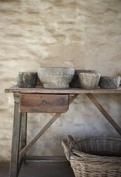 I have the mudbrick wall and the old grey wicker laundry baskets. Just need a wonky table and some old pots and I'm good to go.