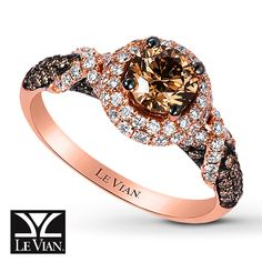 Intertwining rows of Vanilla Diamonds® lend sparkling contrast around the rich Chocolate Diamond center and band lined with additional Chocolate Diamonds® in this elegant ring from Le Vian®. Crafted of sweet 14K Strawberry Gold®, the ring has a total diamond weight of 1 5/8 carats. Le Vian®. Discover the Legend. Diamond Total Carat Weight may range from 1.58 - 1.68 carats.