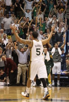 Utah Jazz point guard Devin Harris (5) celebrates with Jazz fans after his 3-point shot put the Jazz up115-107, in overtime in NBA action, Utah Jazz vs. The Orlando Magic, in Salt Lake City,  Saturday, April 21, 2012 (Rick Egan    The Salt Lake Tribune)
