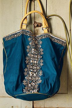 Love this bohemian, silver-embellished turquoise tote! Anthropologie, of course!