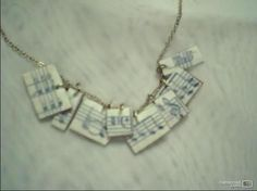 Cardboard charms made of old sheet music .  Make a paper necklace in under 45 minutes by jewelrymaking and decoupaging with jump rings, chain, and cardboard. Inspired by music & bands and clothes & accessories. Creation posted by Christina Y. Difficulty: Simple. Cost: Absolutley free.