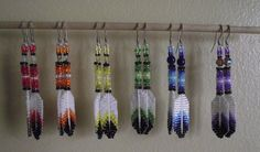 Beaded feather earrings. (Beaded on a porcupine quill)