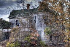 I used to stare out my window driving by old homes like this one through small towns in Georgia and I would imagine its story....