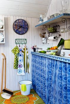 Vintage kitchen ~ in my early childhood, I recall seeing such simple kitchens. Fabrics covered pipes and stored pots & pans. Felt so homey, lots of love.