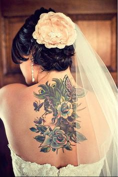 was worried the tattoos might conflict with the wedding dress, but i think it looks good