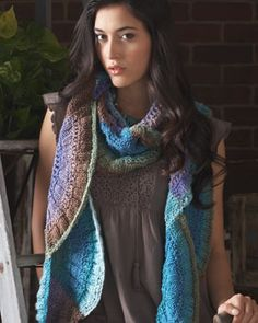 The gradual color changes in Bernat Mosaic turns a simple scallop motif into an amazing nature-inspired scarf.