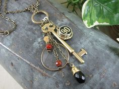 """I love this artist..because I pinned their bullet charm bracelet on my """"High Noon"""" board LOL!!  Etsy shop>>>    thekeyofa      THE KEY OF A, LLC - Upcycled Jewelry & Accessories      Anne      St Louis, Missouri,      United States  >>>""""Antique Monocle/Optician Lens Brass Skeleton Key Necklace Assemblage with Authentic 90 Cash Register Key - Carnelian/Black Onyx Beadwork"""""""