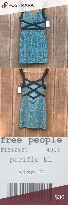 "Free People Cross My Heart Dress Pacific Blue M Sexy form fitting dress with peek a boo cutouts in the back. Measures 16.5"" armpit to armpit, 14.5"" across the waist, and 25.25"" armpit to hem. Free People Dresses"
