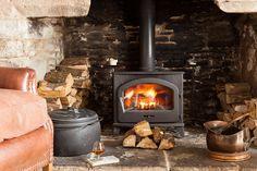 Enjoy the roaring fire at the Tudor Farmhouse Hotel, Clearwell.