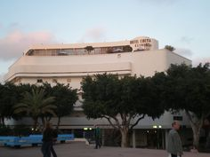 """Hotel Cinema, Bauhaus, Tel Aviv  In 2003, the United Nations Educational, Scientific and Cultural Organization (UNESCO), proclaimed """"The White City"""" of Tel Aviv as a World Cultural Heritage site, for being """"an outstanding example of new town planning and architecture in the early 20th century""""."""
