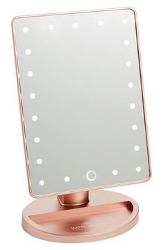 Primp in style with this light-up vanity mirror featuring dimmable, energy-saving LEDs and a smart touch sensor—just tap it to turn on, and hold down to adjust brightness.