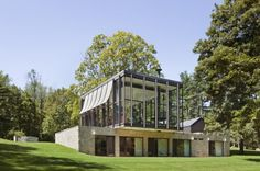 """Residential Architecture: Country Estate by Roger Ferris + Partners: """"..Roger Ferris + Partnersdesigned a country estate in New Canaan, Connecticut, USA..This project expands the program of the original Wiley house, a mid-century modern residence by Philip Johnson, to integrate new structures into the spectacular setting of the house with a design rooted in respectful contextual response and a commitment to conservation strategies. The new art gallery, pool house and garage reinforce the…"""
