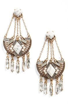 Crystals and stones make for an ultra-chic mix on statement earrings that dress up any ensemble.