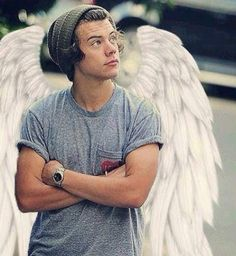 'I can't stop pinning pictures of him with angel wings!' Says original pinner. Can't blame you gurl! Follow rickysturn/harry-styles