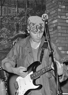 River Phoenix plays guitar