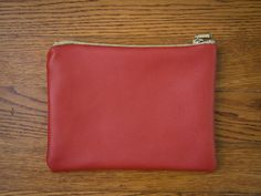 How To Make a Handmade Leather Purse: Flip the pouch right-side out through the zipper hole and arrange the corners so that they lay flat. From DIYnetwork.com