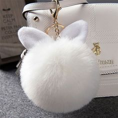 Look at this adorable fuzzy rabbit keychain, it s super stylish for any  purse. I eeff48c06e