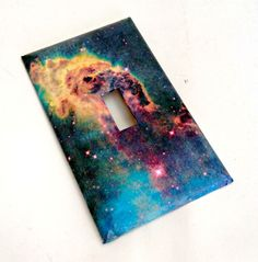 Light switch plate cover with a view of a celestial galaxy and beyond. inches tall and 3 inches wide. Comes with two screws for installation. If you would like this pattern on a different kind of plate cover, just convo me. Switch Plate Covers, Light Switch Plates, Galaxy Decor, Galaxy Space, Little Girl Rooms, Room Themes, Objects, Cool Stuff, Decorations
